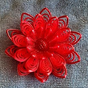 Vintage 1950s red celluloid flower brooch